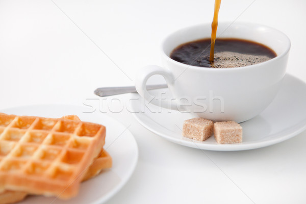 Waffles sugar and a cup of coffee on white plate against a white background Stock photo © wavebreak_media