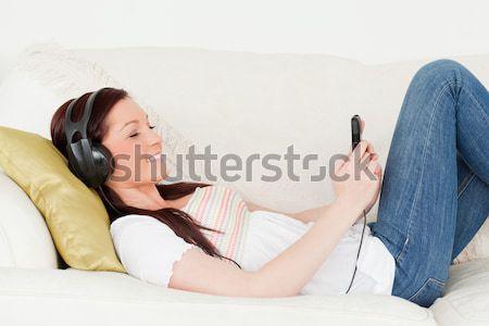 Nevet nő tele bőrönd ágy boldog Stock fotó © wavebreak_media