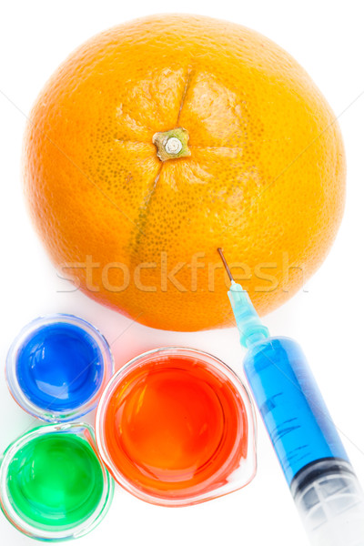 Orange piercing seringue blanche fruits santé Photo stock © wavebreak_media