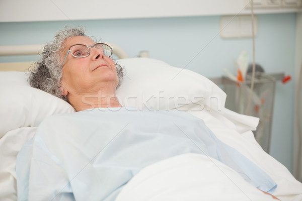 Old sick lady lying in hospital bed Stock photo © wavebreak_media