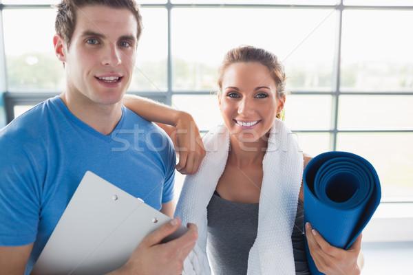 Frau Ausbilder Fitnessstudio lächelnde Frau lächelnd Sport Stock foto © wavebreak_media