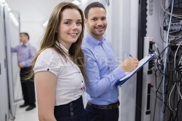 Dos sonriendo servidores centro de datos trabajo red Foto stock © wavebreak_media