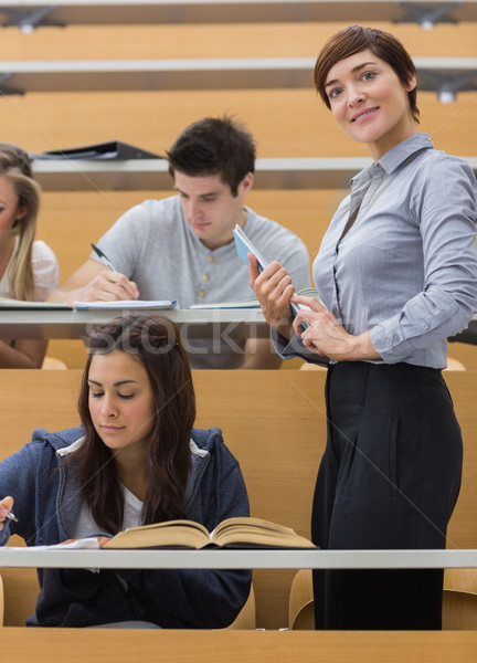 Öğrenciler çalışma öğretmen gülen ders salon Stok fotoğraf © wavebreak_media