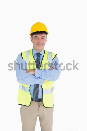 Architect wearing hardhat and high visibility vest with arms crossed Stock photo © wavebreak_media