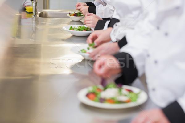 Chefs contrariar homem cozinha restaurante Foto stock © wavebreak_media