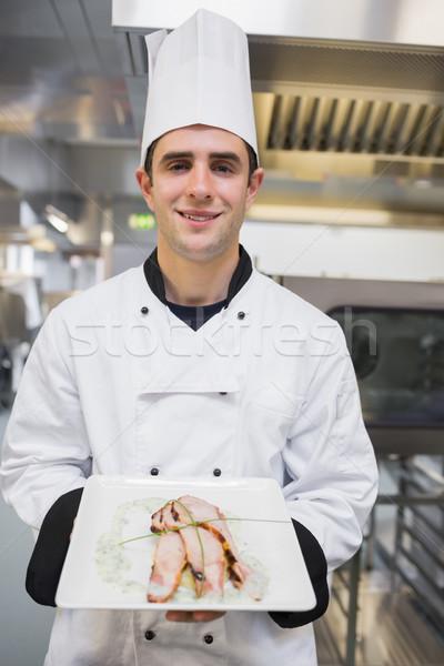 Sonriendo cocinar comida pie cocina Foto stock © wavebreak_media