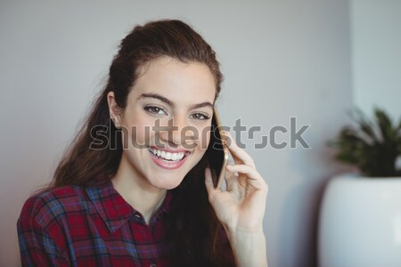 Angry woman holding up knives Stock photo © wavebreak_media