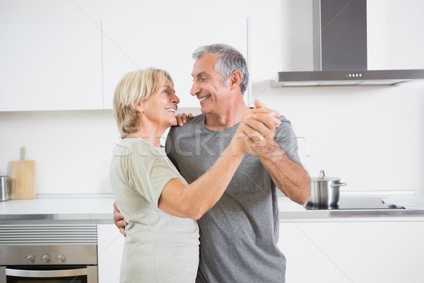 Smiling couple dancing together  Stock photo © wavebreak_media