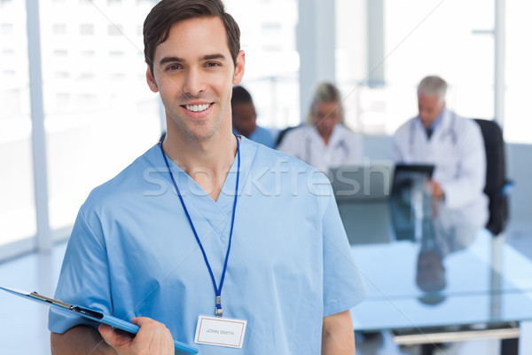 Young doctor holding a file Stock photo © wavebreak_media