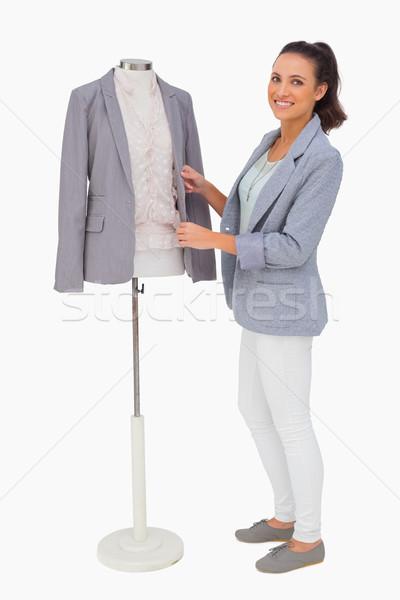 Fashion designer fixing blazer on mannequin Stock photo © wavebreak_media