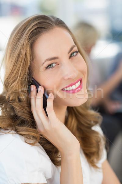 Beautiful businesswoman using mobile phone Stock photo © wavebreak_media