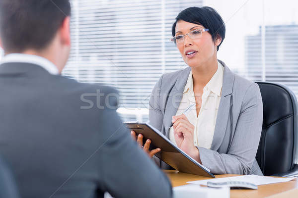 Recruiter checking the candidate during a job interview Stock photo © wavebreak_media
