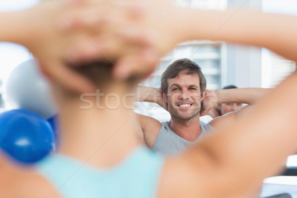 Uśmiechnięty mężczyzna zamazany ludzi Zdjęcia stock © wavebreak_media