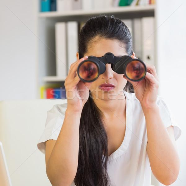 определенный деловая женщина глядя бинокль молодые служба Сток-фото © wavebreak_media