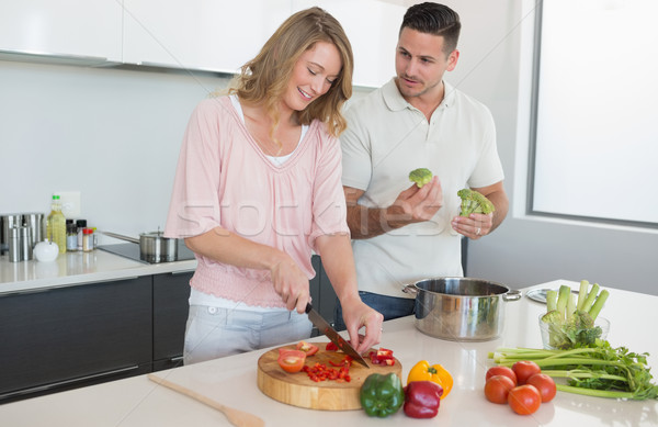 Couple preparing food in kitchen Stock photo © wavebreak_media