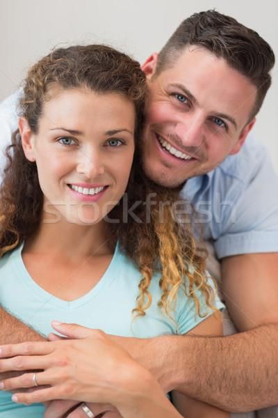 Szeretetteljes férfi átkarol nő otthon portré Stock fotó © wavebreak_media