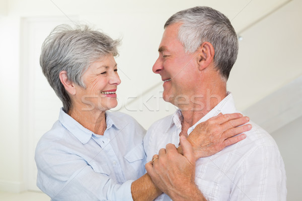Affectionate retired couple smiling at each other Stock photo © wavebreak_media