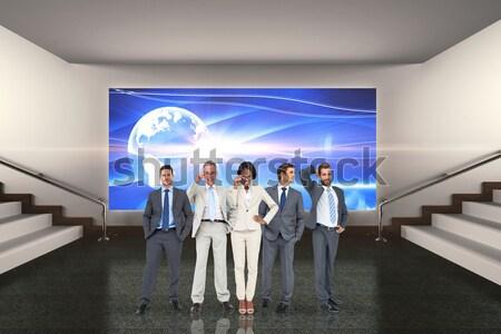 Szczęśliwy zespół firmy za pomocą laptopa bezpieczeństwa interfejs digital composite Zdjęcia stock © wavebreak_media