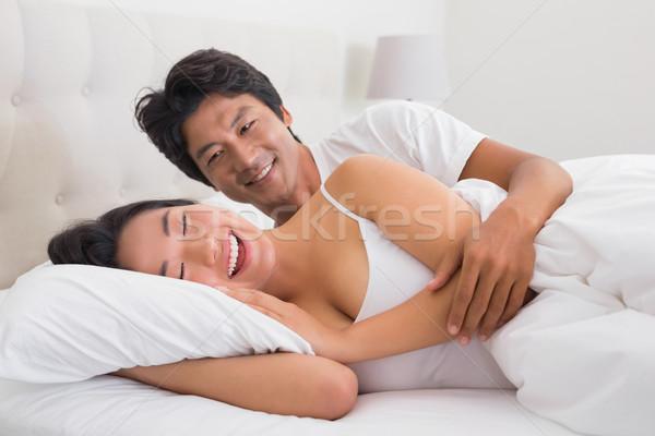 Sorridente casal cama casa quarto casa Foto stock © wavebreak_media