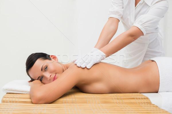 Beautiful brunette enjoying an exfoliating back massage Stock photo © wavebreak_media