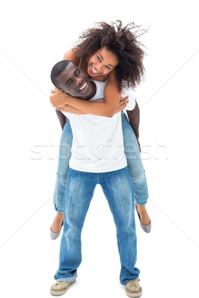 Casual hombre sonriendo compañera atrás Foto stock © wavebreak_media