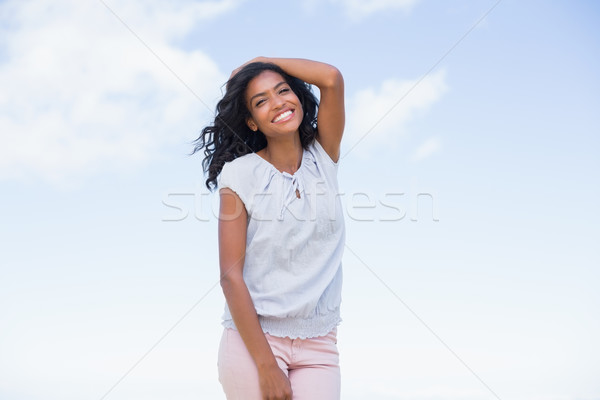 カジュアル きれいな女性 笑みを浮かべて カメラ ストックフォト © wavebreak_media