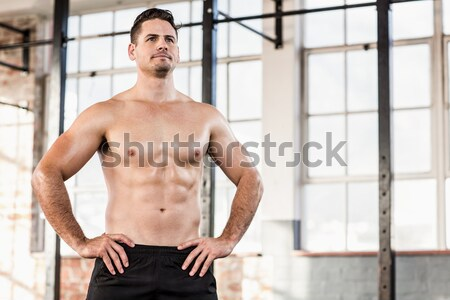 Shirtless muscular man posing in gym Stock photo © wavebreak_media