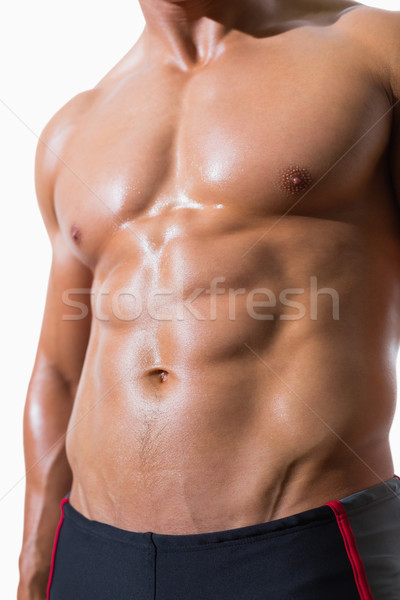 Sin camisa muscular hombre pie blanco Foto stock © wavebreak_media