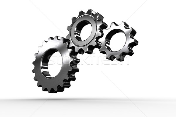 Metal cogs and wheels connecting Stock photo © wavebreak_media