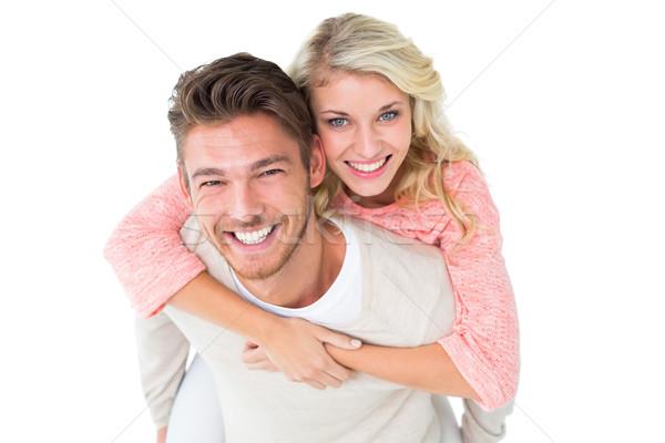 Jóképű férfi malac hát barátnő fehér férfi Stock fotó © wavebreak_media