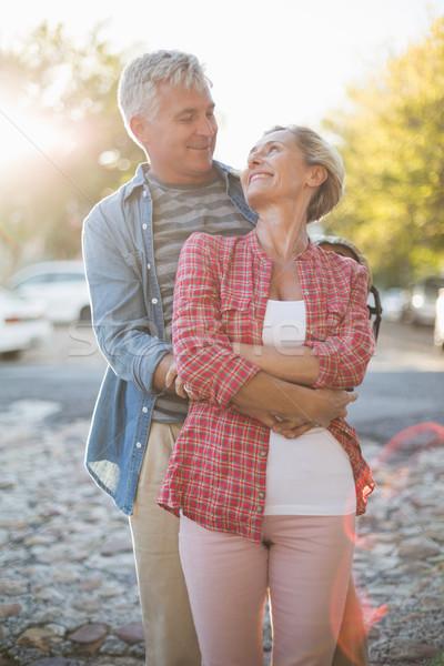 Happy mature couple hugging in the city Stock photo © wavebreak_media