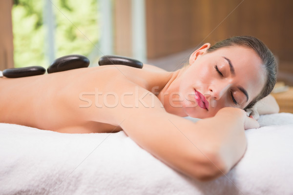Beautiful woman receiving stone massage at health farm Stock photo © wavebreak_media