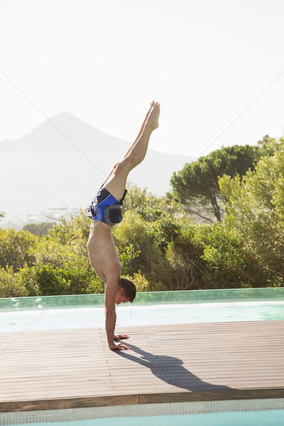 человека стойка на руках Бассейн вид сбоку молодым человеком Сток-фото © wavebreak_media