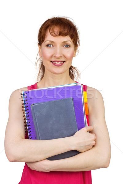 Nő tart iskola jegyzetfüzetek néz kamera Stock fotó © wavebreak_media