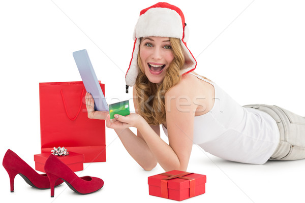 Woman holding a credit card surrounded with gifts Stock photo © wavebreak_media