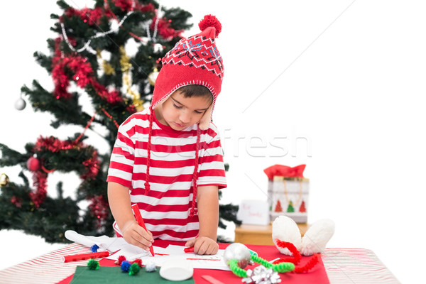 Festive little boy drawing pictures Stock photo © wavebreak_media