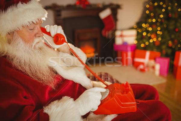 Kerstman telefoongesprek home woonkamer huis Stockfoto © wavebreak_media