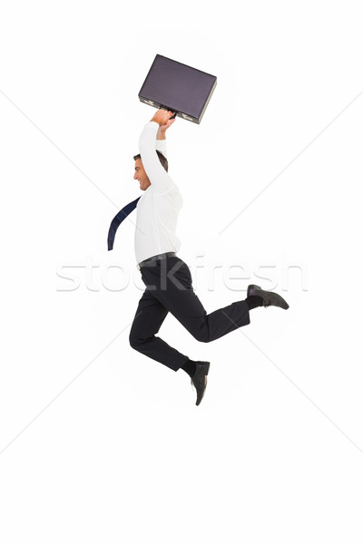 Smiling businessman leaping while briefcase Stock photo © wavebreak_media
