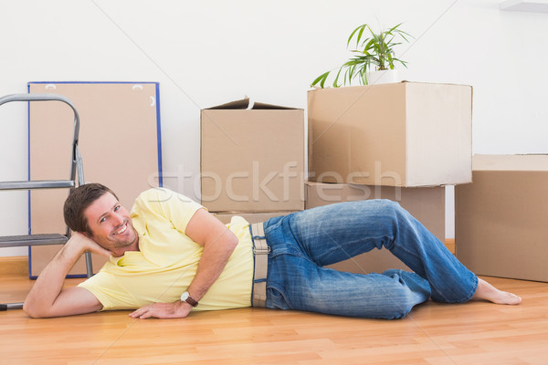 Happy man posing with moving boxes at home  Stock photo © wavebreak_media