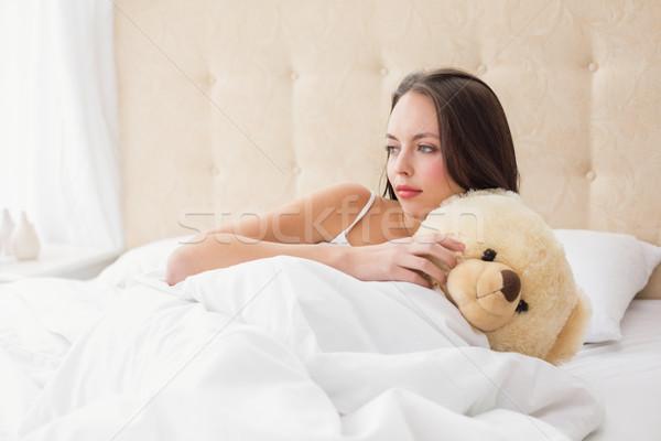 довольно брюнетка мишка домой спальня счастливым Сток-фото © wavebreak_media