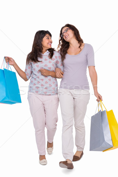 Smiling friends walking with shopping bags Stock photo © wavebreak_media