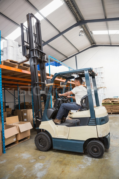 Forklift machine in a large warehouse Stock photo © wavebreak_media