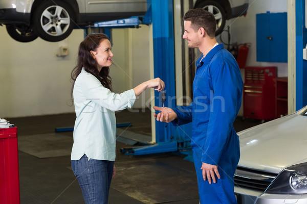 Customer giving her car keys to mechanic Stock photo © wavebreak_media