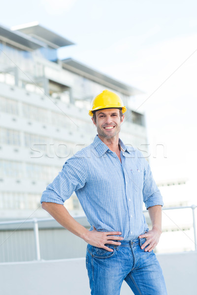 Handsome architect with hands on hips outdoors Stock photo © wavebreak_media
