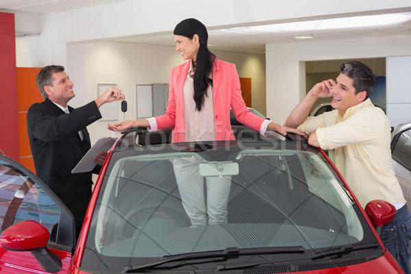 Derűs nő áll piros cabrio új autó Stock fotó © wavebreak_media