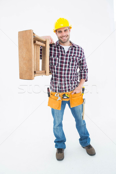 Confident handyman carrying ladder Stock photo © wavebreak_media