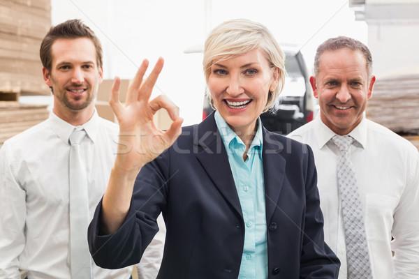 Sorridente armazém gerente okay gesto Foto stock © wavebreak_media