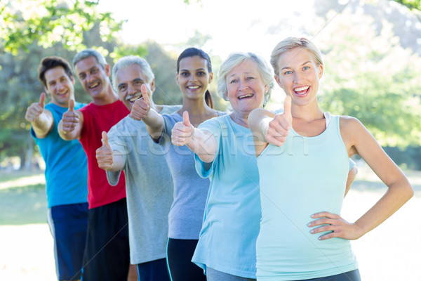Happy athletic group with thumbs up  Stock photo © wavebreak_media