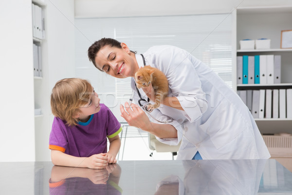 Veterinarian doing injection at a cat with its owner  Stock photo © wavebreak_media