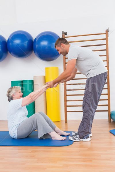 Trainer working with senior woman on exercise mat  Stock photo © wavebreak_media